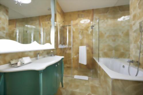 Our Luxury Rooms all offer a beautiful onyx bathroom with a separate shower and tub