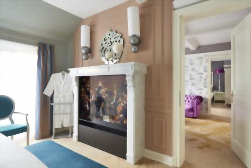 "The bedrooms feature a 55"" flat screen presented in a marble fireplace mantle."