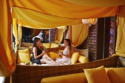 Catch up over a cocktail under the canopies of Harmony Spa Wellness Center.