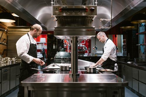 Chef's at work in the show kitchen at Liszt Restaurant.